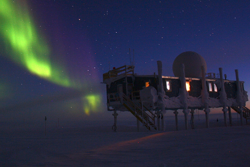 NOAA scientists work at an international observatory in Greenland monitoring the changing ice, shown here with the northern lights. Credit: Christopher Cox/NOAA