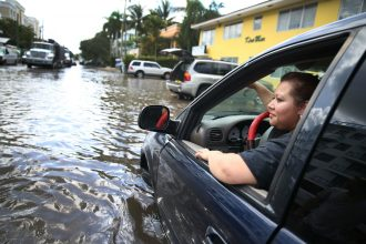In Miami Beach, high tides are creating street flooding problems as sea level rises. It isn't just during hurricanes any more. Credit: Joe Raedle/Getty Images