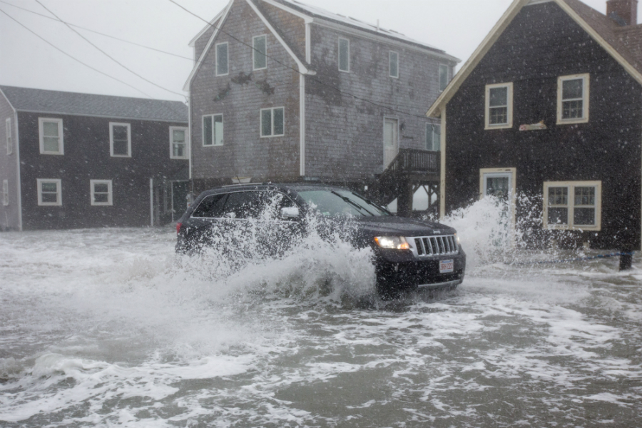 During this winter's nor'easters, high tides flooded the streets of Scituate, Massachusetts. The town faces rising costs to keep the ocean at bay. Credit: Scott Eisen/Getty Images