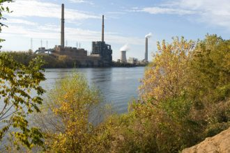 The Ohio River has 26 coal-fired power plants along its banks, about one every 38 miles. For decades, a regional commission has overseen standards for water pollution that crosses state lines. Credit: Saul Loeb/Getty Images