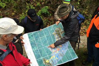 An Austrian ranger explains to a group of landowners how maintaining old-growth forest in the Dürrenstein Wilderness area helps Austria meet its climate targets by sequestering carbon. By Bob Berwyn