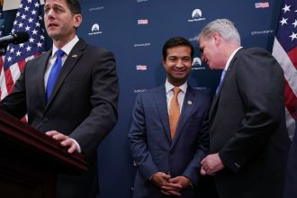 House Majority Leader Kevin McCarthy whispers to Republican Rep. Carlos Curbelo as House Speaker Paul Ryan talks at the podium. Credit: Chip Somodevilla/Getty Images