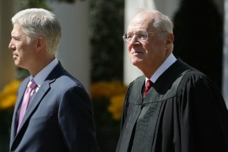 Supreme Court Justice Anthony Kennedy (right), swore in the newest Supreme Court justice, Neil Gorsuch, in 2017. Credit: Chip Somodevilla/Getty Images