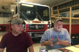 Mayking Fire Chief Tony Fugate (left) and the volunteer fire department's treasurer, Buddy Sexton, speak to residents about their station's rising electricity costs during an Aug. 2 public meeting. Credit: James Bruggers/InsideClimate News