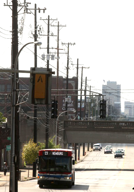 Telephone poles line Broadway as it cuts through downtown Louisville, but there are few trees. Credit: Michael Hayman/TreesLouisville