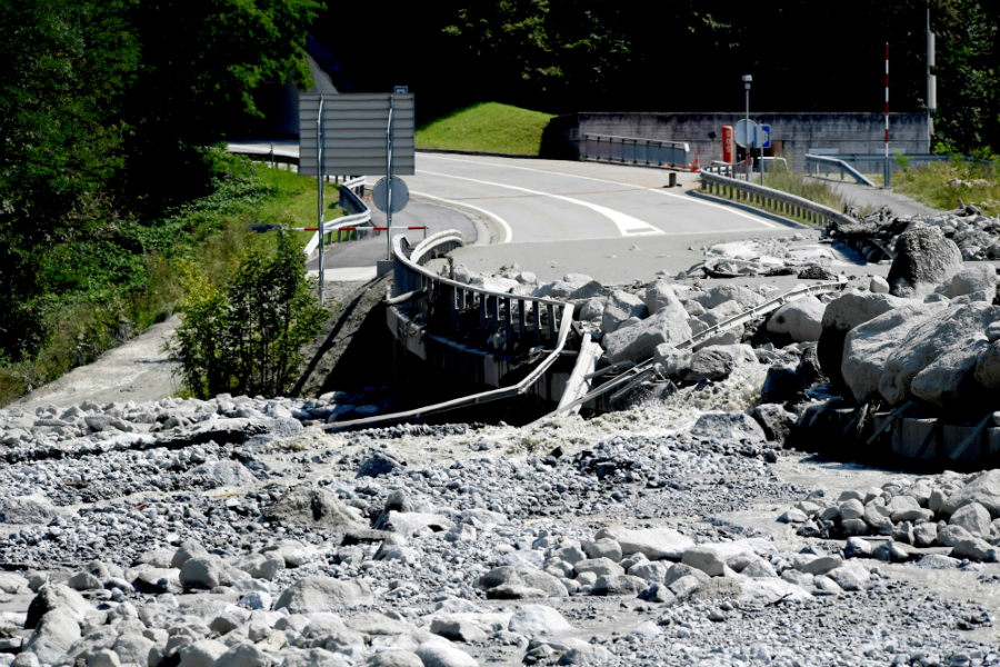 A 2017 landslide in the Swiss Alps left giant boulders strung across damaged roadways. Credit: Miguel Medina/AFP/Getty Images
