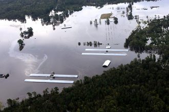 Dozens of livestock farms with chickens and hog waste lagoons in the Carolinas were inundated by Hurricane Florence's extreme rainfall. Credit: Rick Dove/Waterkeeper Alliance