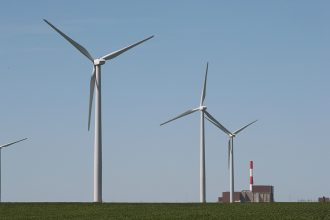 Wind turbines tower over Exelon's nuclear power plant near Marseilles, Illinois. Credit: Scott Olson/Getty Images