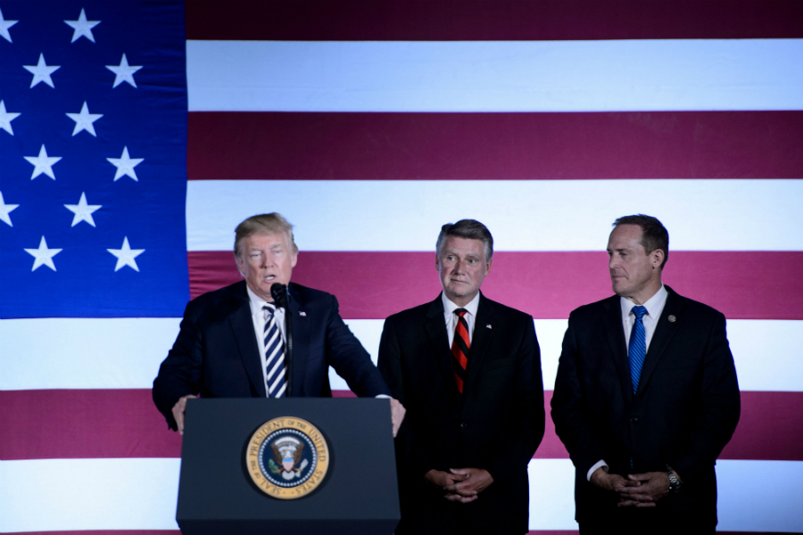 President Donald Trump lauded Republican candidate Mark Harris (center), a conservative former Baptist pastor, during an event in North Carolina on Sept. 1. Credit: Brendan Smialowski/AFP/Getty Im