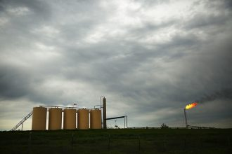 A natural gas operation in Texas, with flaring underway. Credit: Spencer Platt/Getty Images