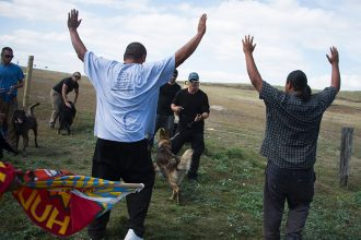 Native American protestors are confronted by security during a demonstration in 2016 against the Dakota Access oil pipeline, which they will pollute water supplies for the Standing Rock Reservation just downstream. Credit: Robyn Beck/AFP/Getty Im