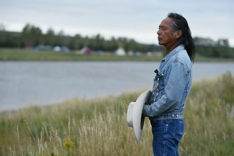 Ron His Horse Is Thunder, a former chairman of the Standing Rock Sioux Tribe, stands near the Dakota Access Pipeline protest camp in 2016. Credit: Robyn Beck/AFP/Getty Images