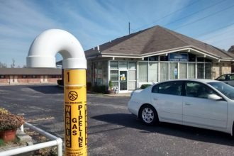 Kinder Morgan natural gas pipeline that was to be repurposed for natural gas liquids runs next to a senior citizens center in Richmond, Kentucky. Credit: Katie Gardner/Courtesy Kentucky Heartwood and Safety on the Line.
