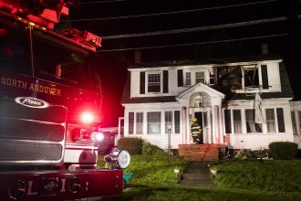 A series of natural gas explosions and fires damaged homes across three Massachusetts communities on Sept. 13, 2018. Credit: Adam Glanzman/Getty Images