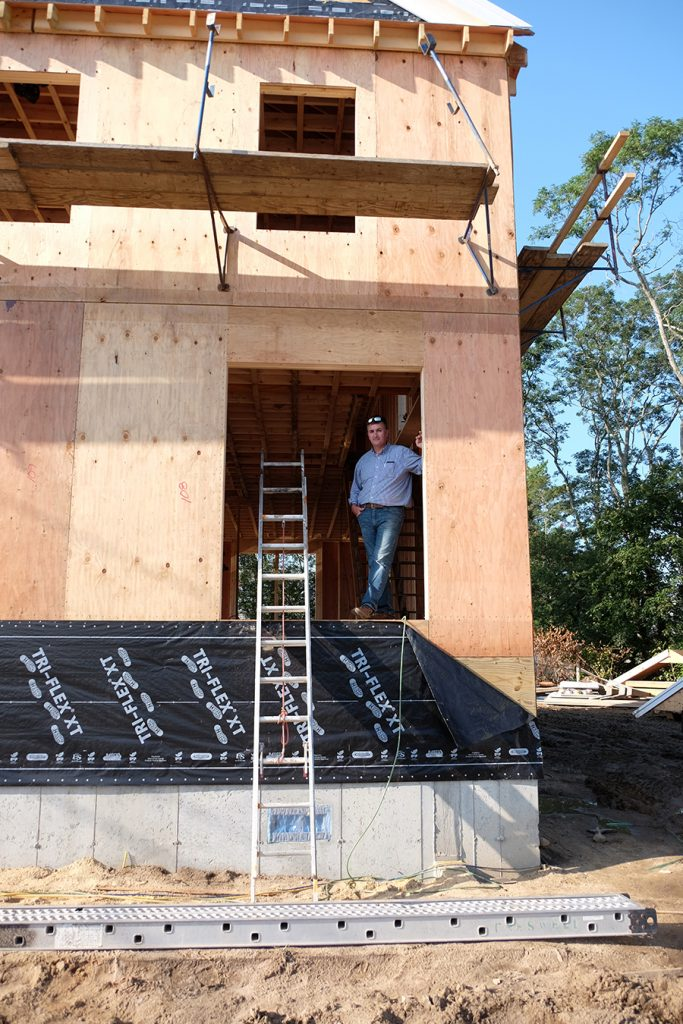 Matt Teague stands on the first floor of his newly elevated house, which is 1 foot above the required base flood elevation height that building codes require. Credit: Meera SubramanianMatt Teague stands on the first floor of his new, elevated house, which