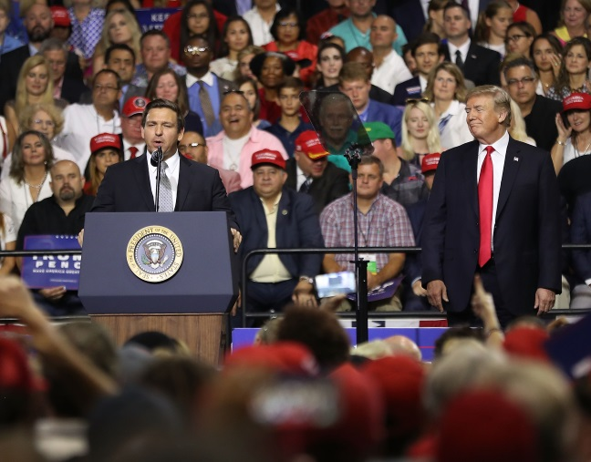 Ron DeSantis speaks at a rally in Tampa, Florida with President Donald Trump. Credit: Joe Raedle/Getty Images