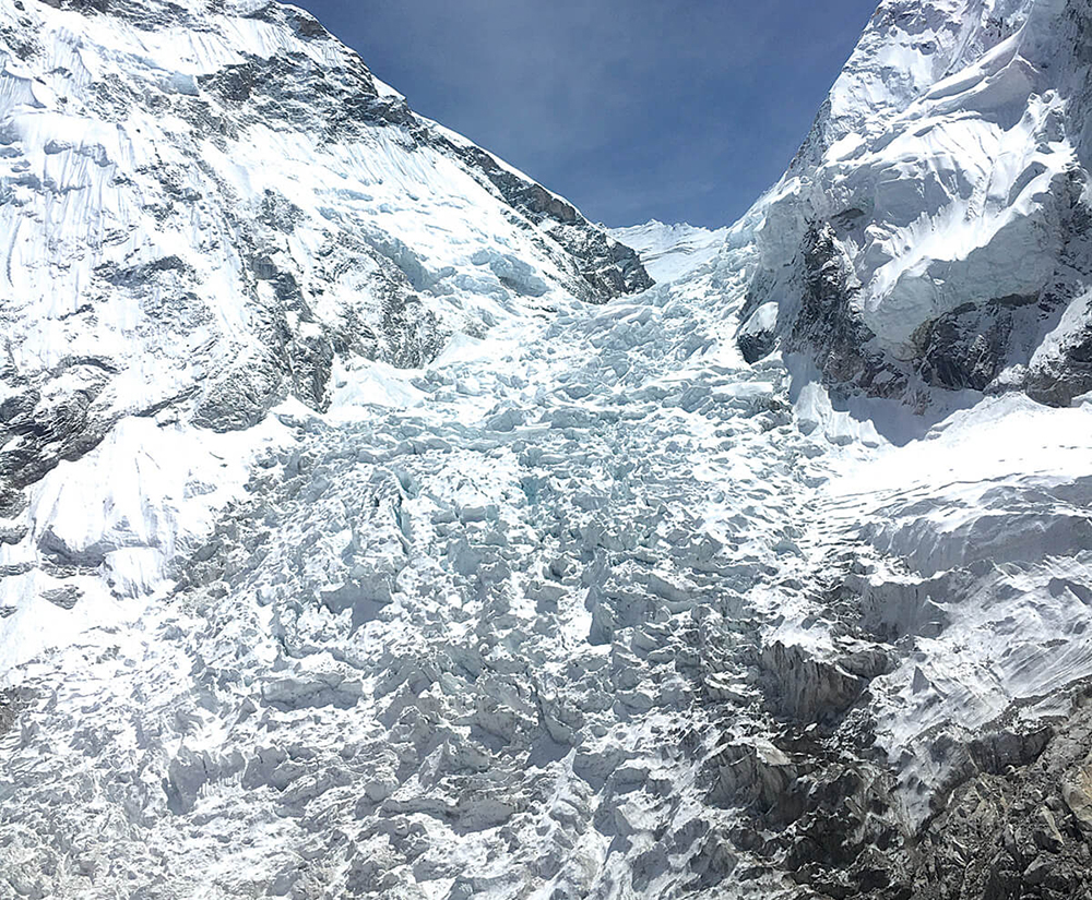 The Khumbu Icefall funnels debris and ice down to the Khumbu Glacier, 1,000 meters below. Credit: Kunda Dixit/Nepali Times