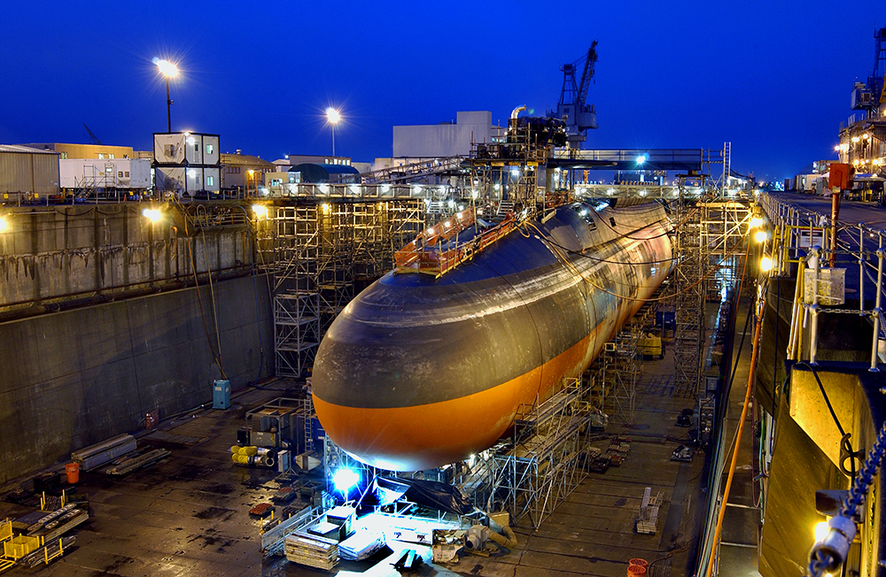 Dry-docking a submarine allows crews to open it up and extend its length or perform maintenance, like this work, underway in the shipyard at Bremerton, Washington. Credit: Richard Chaffee/U.S. Navy