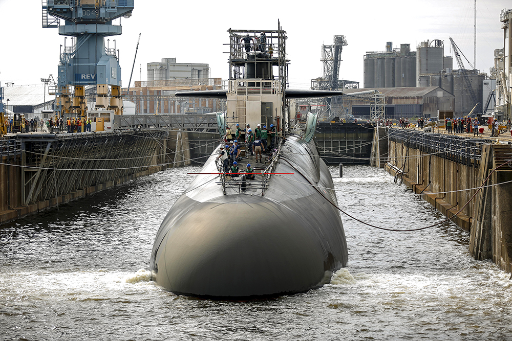 Workers stand on a submarine at Norfolk Naval Shipyard. Credit: Shayne Hensley/Norfolk Naval Shipyard