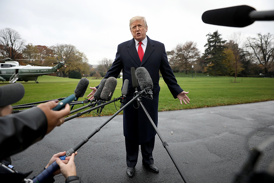 """I don't believe it,"" President Donald Trump told reporters on Nov. 26 when asked about the National Climate Assessment's finding that global warming is causing ongoing and lasting economic damage. Credit: Win McNamee/Getty Images"