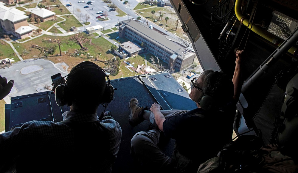 Secretary of the Air Force Heather Wilson (right) and John W. Henderson, assistant secretary for installations, environment and energy, fly over Tyndall Air Force Base in the aftermath of Hurricane Michael. Credit: Senior Airman Joseph Pick/U.S. Air Force