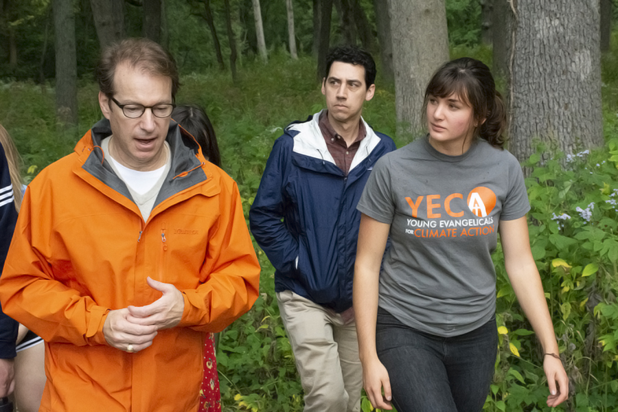 Chelsey Geisz (right)  talks with U.S. Rep. Peter Roskam about climate change during a nature walk near Wheaton College. Roskam was defeated in the 2018 election by an energy efficiency engineer. Credit: Jess Smith