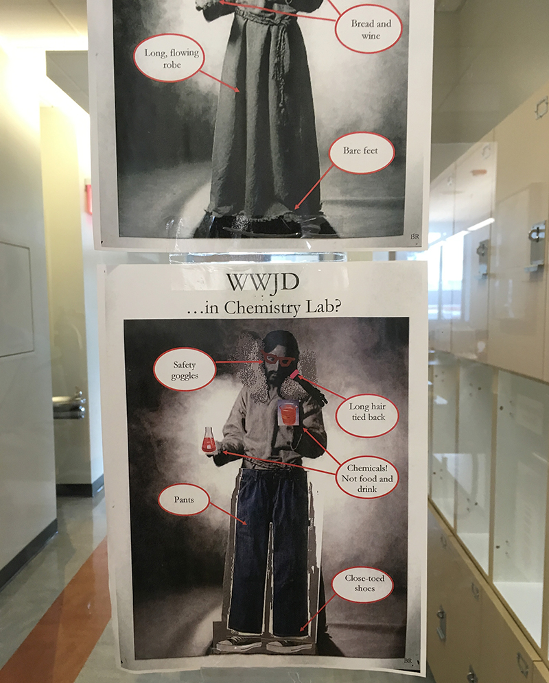 A sign in a Wheaton College science building: What Would Jesus Do in chemistry lab?