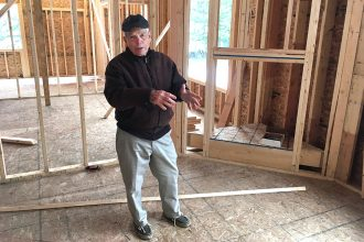Home-builder Bill Decker explains some of the techniques used to create highly energy-efficient homes in chilly southeast Michigan. Credit: Dan Gearino/InsideClimate News