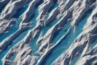 Rivers of meltwater form on the surface of the Greenland Ice Sheet in the summers. Credit: John Sonntag/NASA