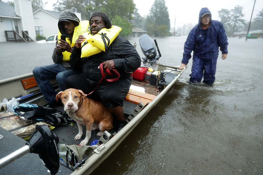 Volunteers helped rescue residents from flooded homes in New Bern, North Carolina, on the Neuse River, during Hurricane Florence. Credit: Chip Somodevilla/Getty Images