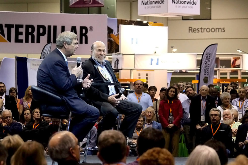 Bob Stallman (center), president of the American Farm Bureau Federation from 2000 to 2016, with then-Agriculture Secretary Tom Vilsack at a Farm Bureau convention in 2016. Credit: Elizabeth Moore/USDA
