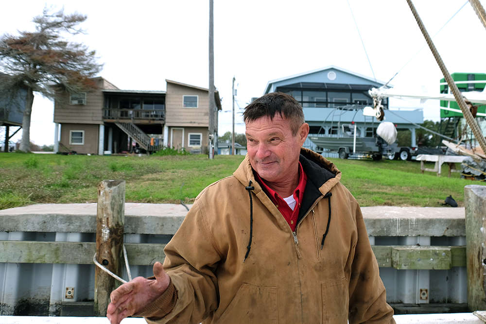 Steve Pirhoda has been shrimping from Palacios since 1974. His shrimp boat is lashed to pilings in the backyard of his waterfront home as he begins a gut renovation of the wheelhouse. Credit: Meera Subramanian