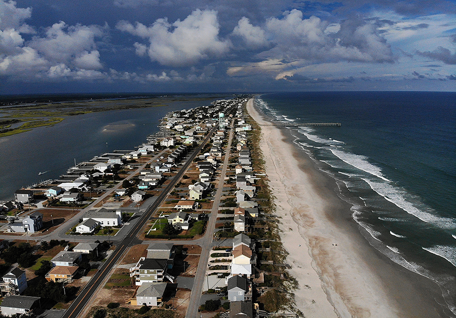 Despite the risk of hurricane damage, people continue building homes at the ocean's edge. Homes on Topsail Beach, shown here before Hurricane Florence, took a beating in the storm. Credit: Mark Wilson/Getty Images