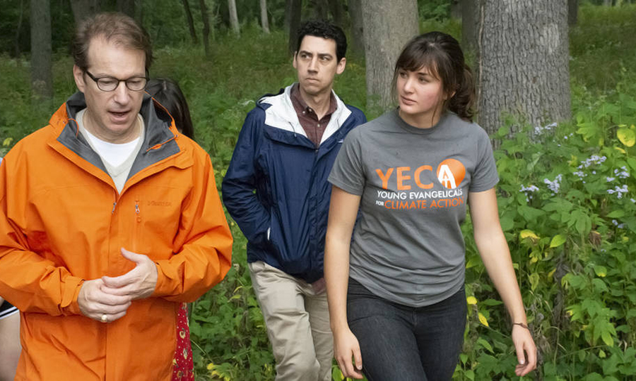 Chelsey Geisz talks with Rep. Peter Roskam about climate change during a nature walk near Wheaton College. Credit: Jessie Smith
