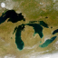 Algae blooms have become a growing problem as temperatures warm, particularly on Lake Erie, where rivers also feed them with nutrients from farm runoff. Credit: Jesse Allen and Robert Simmon/NASA