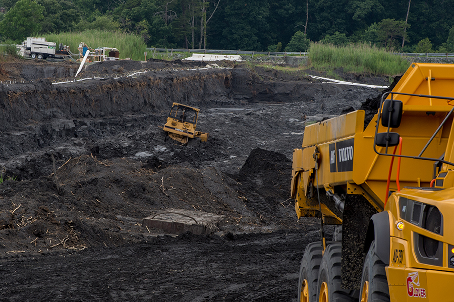 Removing coal ash from ponds at Dominion Energy's Possum Point power plant in Dumfries, Va. Credit: Kate Patterson/Washington Post via Getty Images.