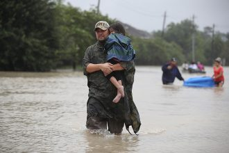 Studies have connected several extreme weather events, including Hurricane Harvey's record rainfall in the Houston area in 2017, to global warming. Credit: Joe Raedle/Getty Images