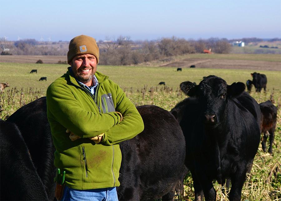 Seth Watkins on his farm in Iowa. Credit: Tatum Watkins