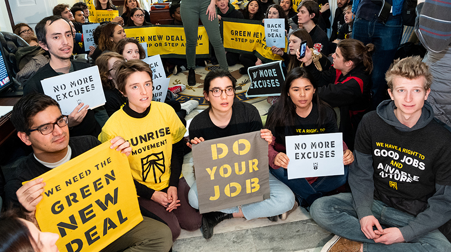 Members of the Sunrise Movement held a sit-in at incoming House Speaker Nancy Pelosi's office shortly after the election demanding action on climate change. Credit: Michael Brochstein/SOPA Images/LightRocket via Getty Images
