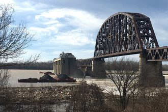 In December, nine coal barges broke loose on the Ohio River, and several sank along with their cargo at a dam near Louisville. Credit: James Bruggers