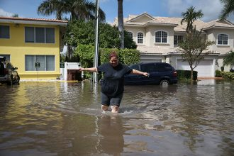 High-tide flooding is becoming a problem in a growing number communities as sea level rises. New research shows the impact it's already having on home values. Credit: Joe Raedle/Getty ImagesHigh-tide flooding is becoming a problem in a growing number or c