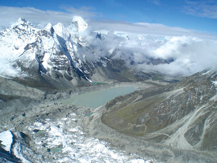 Imja Tso, a glacial lake, did not exist on trekking maps 30 years ago. Today it is 2 kilometers long and 1 kilometer wide. Credit: Kunda Dixit/Nepali Times