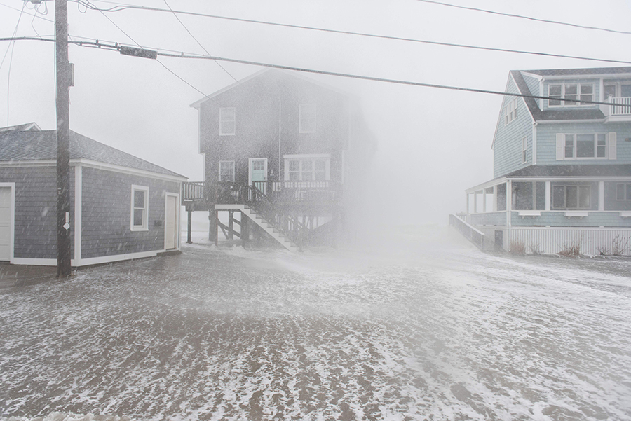 The ocean poured through the streets of Scituate, Massachusetts, during a storm on March 2. Sea level rise is increasing the flood risk in many areas during high tides and storm surges. Credit: Ryan McBride/AFP/Getty Images