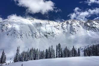 At Arapahoe Basin and other areas of Colorado, controlled avalanches are used to clear away unstable snowpack and avoid putting skiers and drivers in danger. Credit: Bob Berwyn