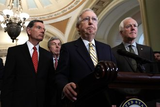 Senate Majority Leader Mitch McConnell of Kentucky, flanked by Sen. John Barrasso (R-Wyo.) and John Cornyn (R-Texas). Credit: Alex Wong/Getty Images