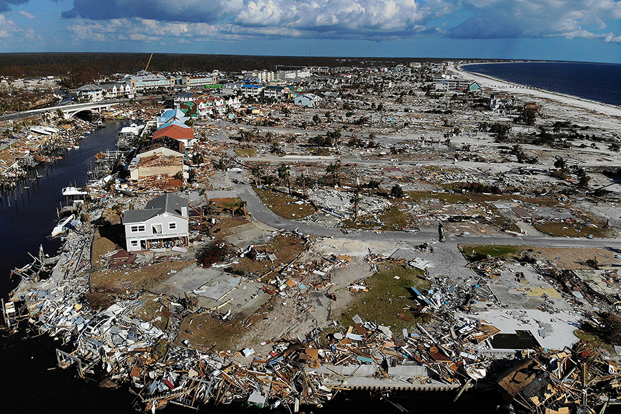 A photo of Mexico Beach looking east across the canal shows several of the properties where homes were destroyed that FEMA's draft map moves from the high-risk 100-year floodplain to the lower-risk 500-year floodplain. Credit: Joe Raedle/Getty Images