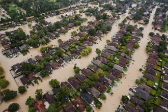 A photo of Mexico Beach looking east across the canal shows several of the properties where homes once lined the canal that FEMA's draft map moves from the high-risk 100-year floodplain to the lower-risk 500-year floodplain. Credit: Joe Raedle/Getty Image