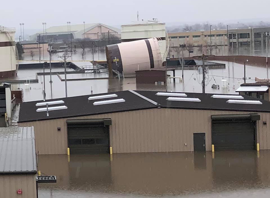 The flooding surrounded fuel tanks at Offutt Air Force Base and tipped over over one, which military officials said was empty and had been decommissioned years ago. Credit: 55th Wing Command