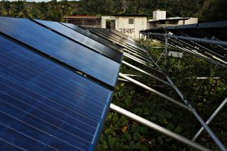 Remote regions of Puerto Rico have been using solar power for years. Now the U.S. territory's legislature has approved a rapid, territory-wide scale-up to 100 percent clean energy by 2050. Credit: David S. Holloway/Getty Images