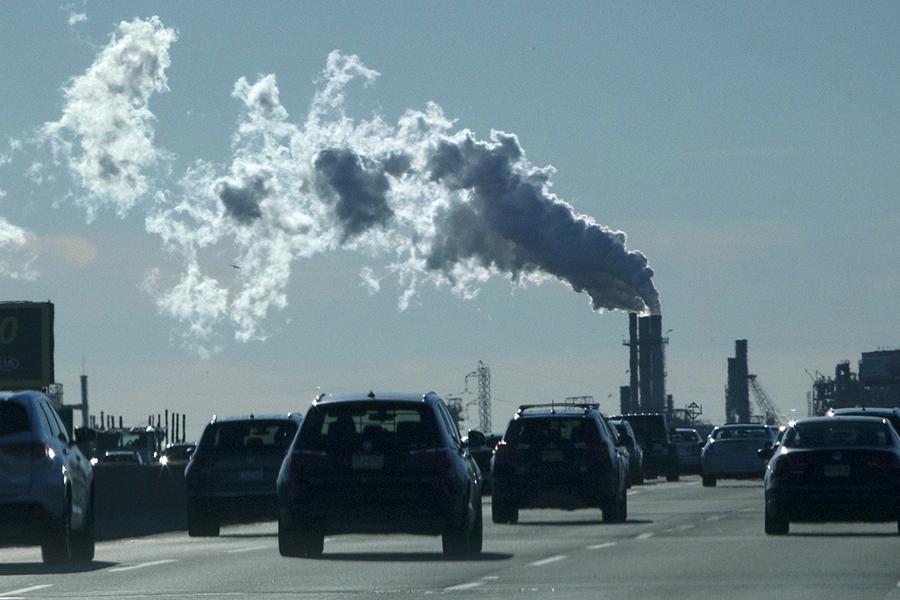 Highway and industry. Credit: Kena Betancur/VIEWpress/Corbis via Getty Images